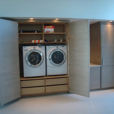 Modern Laundry Room by Woodlane Cabinet Company