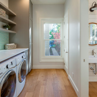 Mid-sized country single-wall light wood floor utility room photo in San Francisco with shaker cabinets, gray cabinets, quartz countertops and a side-by-side washer/dryer