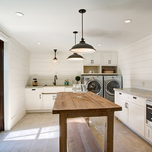 Large cottage l-shaped ceramic tile and beige floor laundry room photo in San Francisco with a farmhouse sink, white cabinets, solid surface countertops, white walls, a side-by-side washer/dryer and shaker cabinets