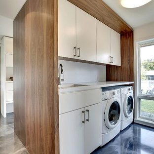 Minimalist galley blue floor laundry room photo in Minneapolis with flat-panel cabinets, white cabinets, white walls and white countertops