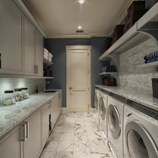 Laundry room - transitional gray floor laundry room idea in Miami with gray cabinets