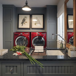 Utility room - large industrial galley utility room idea in New York with gray cabinets, granite countertops, gray walls, shaker cabinets and an undermount sink