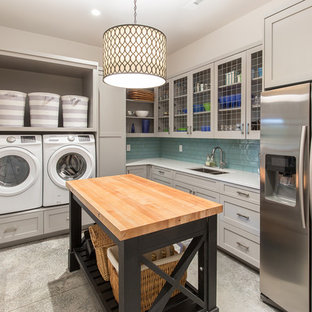Transitional l-shaped gray floor utility room photo in Other with an undermount sink, shaker cabinets, gray cabinets, white walls and a side-by-side washer/dryer