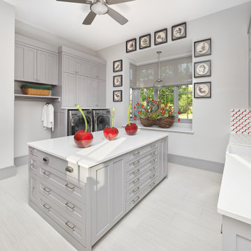 Storage Drawers, Sink and Island in Multi-Purpose Laundry Room