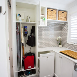 Small traditional l-shaped dedicated laundry room in Brisbane with a single-bowl sink, shaker cabinets, white cabinets, quartz benchtops, white walls, porcelain floors, grey floor and white benchtop.
