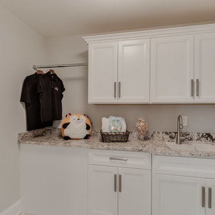Dedicated laundry room - transitional l-shaped ceramic tile dedicated laundry room idea in DC Metro with an undermount sink, recessed-panel cabinets, white cabinets, granite countertops, gray walls, a side-by-side washer/dryer and multicolored countertops