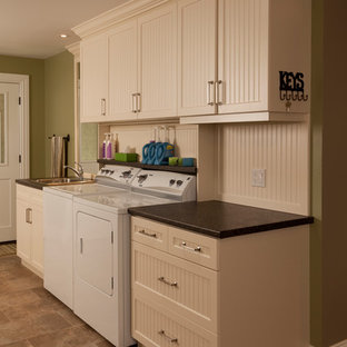 Inspiration for a timeless ceramic floor laundry room remodel in Toronto with a drop-in sink, white cabinets, green walls and a side-by-side washer/dryer