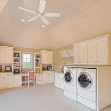 Traditional Laundry Room by Summit Signature Homes, Inc.