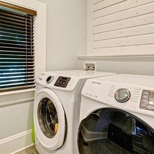 Idee per una sala lavanderia boho chic di medie dimensioni con lavatoio, pareti grigie, pavimento con piastrelle in ceramica, lavatrice e asciugatrice affiancate e pavimento grigio