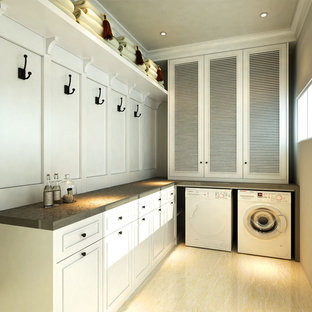 Example of a transitional laundry room design in Other