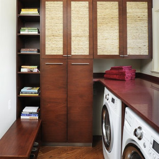 Photo of a contemporary laundry room in San Francisco with red benchtop.