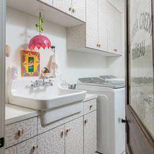 Dedicated laundry room - transitional single-wall beige floor dedicated laundry room idea in Other with an utility sink, flat-panel cabinets, laminate countertops, white walls, a side-by-side washer/dryer and white countertops