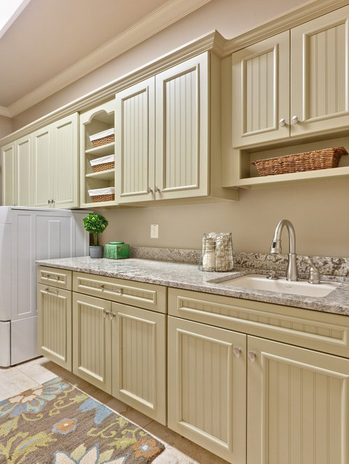 Elegant Laundry Room Photo In Atlanta With Beige Cabinets