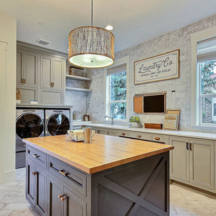Utility room - huge country u-shaped ceramic tile and beige floor utility room idea in Portland with an undermount sink, shaker cabinets, green cabinets, quartz countertops, gray walls, a side-by-side washer/dryer and brown countertops