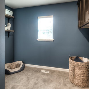 Example of a mid-sized classic l-shaped vinyl floor and gray floor dedicated laundry room design in Seattle with beaded inset cabinets, brown cabinets and a side-by-side washer/dryer