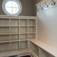 Traditional Laundry Room by Artisan Building and Design, LLC