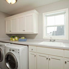Traditional Laundry Room by Robert Thomas Homes