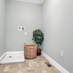 Dedicated laundry room - mid-sized traditional linoleum floor dedicated laundry room idea in Other with gray walls and a side-by-side washer/dryer
