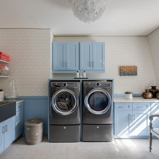 Dedicated laundry room - transitional l-shaped carpeted and beige floor dedicated laundry room idea in New York with a farmhouse sink, shaker cabinets, blue cabinets, beige walls, a side-by-side washer/dryer and beige countertops