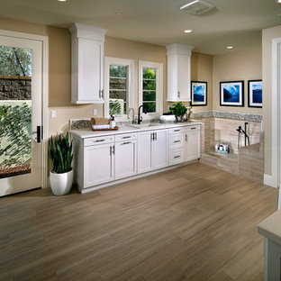 Example of a huge coastal u-shaped utility room design in San Diego with shaker cabinets, white cabinets and quartz countertops