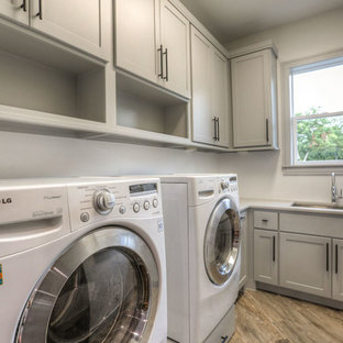 Large arts and crafts l-shaped ceramic floor and beige floor dedicated laundry room photo in Houston with an undermount sink, shaker cabinets, beige cabinets, quartz countertops and white walls