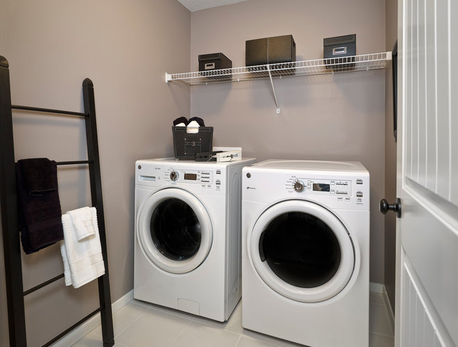 Eclectic Laundry Room by Homes by Avi