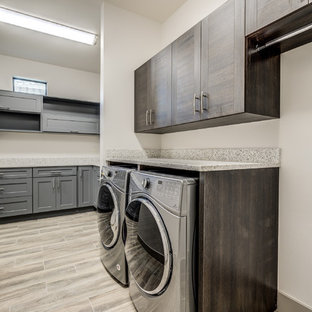 Design ideas for a large traditional separated utility room in Miami with flat-panel cabinets, dark wood cabinets and a side by side washer and dryer.