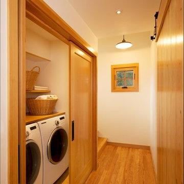 The Laundry: tucked away behind fir doors with flipper door hardware.
