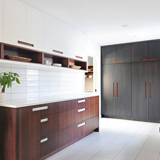 Inspiration for a large contemporary porcelain tile and white floor utility room remodel in Indianapolis with an utility sink, flat-panel cabinets, white cabinets, quartz countertops, white walls and white countertops