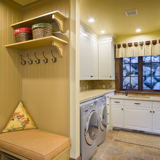 Example of a classic u-shaped laundry room design in Portland with a side-by-side washer/dryer and beige countertops