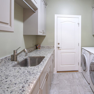 Example of an arts and crafts laundry room design in Other