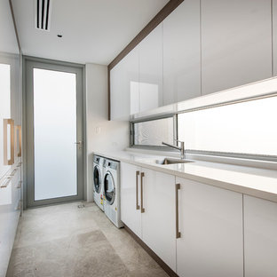 Example of a trendy dedicated laundry room design in Perth with a side-by-side washer/dryer
