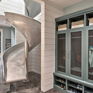 This is an example of a contemporary laundry room in Austin with turquoise cabinets, concrete floors and grey floor.