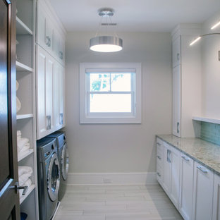 Inspiration for a mid-sized coastal galley porcelain tile and beige floor dedicated laundry room remodel in Milwaukee with recessed-panel cabinets, white cabinets, granite countertops, blue backsplash, porcelain backsplash, beige walls, a side-by-side washer/dryer and beige countertops