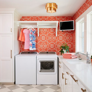 Traditional dedicated laundry room in Minneapolis with an undermount sink, recessed-panel cabinets, white cabinets, a side-by-side washer and dryer, multi-coloured floor, white benchtop and red walls.