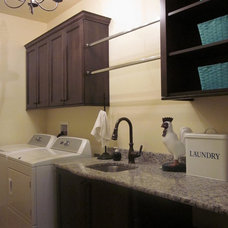 Traditional Laundry Room by E Builders Homes