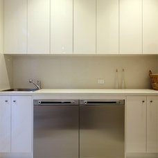 Contemporary Laundry Room by AKL Designer Kitchens
