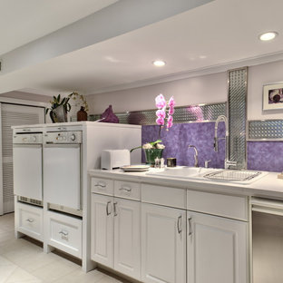 Example of a trendy laundry room design in Seattle with a side-by-side washer/dryer