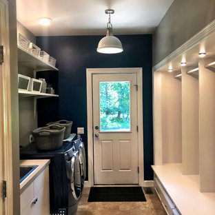 Dedicated laundry room - small traditional galley ceramic tile and beige floor dedicated laundry room idea in Philadelphia with a drop-in sink, shaker cabinets, white cabinets, quartz countertops, blue walls, a side-by-side washer/dryer and gray countertops