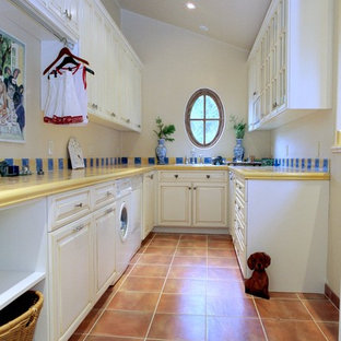 Elegant terra-cotta floor laundry room photo in San Francisco with yellow countertops