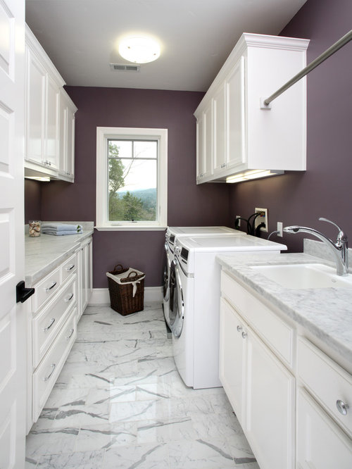 Elegant white floor laundry room photo in San Francisco with purple walls  and white cabinets