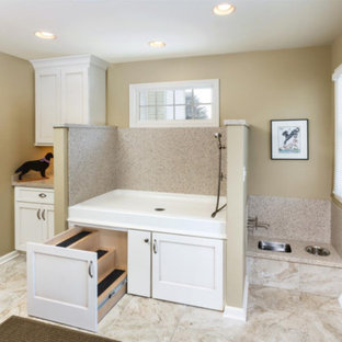 Large classic utility room in Grand Rapids with an utility sink, shaker cabinets, white cabinets, limestone worktops, beige walls, marble flooring and beige floors.