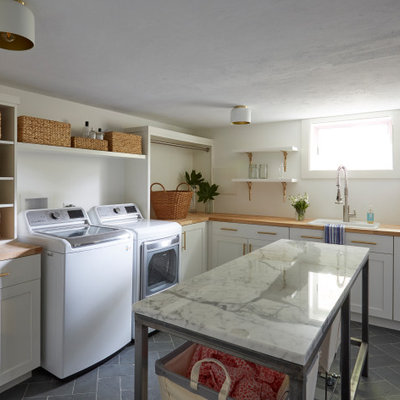 Large farmhouse l-shaped slate floor and gray floor laundry room photo in Other with a drop-in sink, shaker cabinets, white cabinets, white walls and a side-by-side washer/dryer