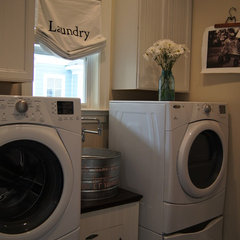 traditional laundry room by Reico Kitchen & Bath