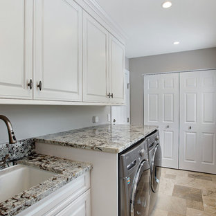 Inspiration for a small transitional single-wall ceramic tile utility room remodel in Chicago with an undermount sink, raised-panel cabinets, white cabinets, granite countertops, gray walls and a side-by-side washer/dryer
