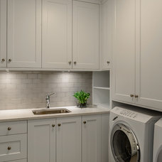Transitional Laundry Room by Joshua Lawrence Studios INC