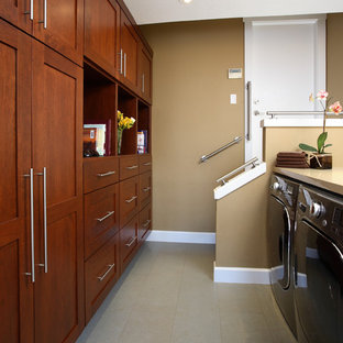 Example of a transitional gray floor laundry room design in San Francisco with beige walls