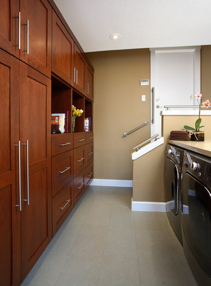 Contemporary Laundry Room by Precision Cabinets