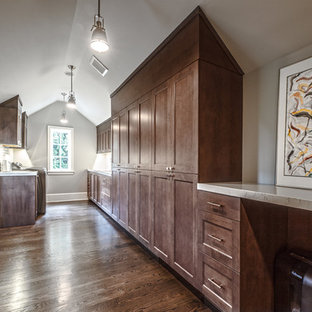 Photo of a large classic galley separated utility room in Seattle with a submerged sink, recessed-panel cabinets, dark wood cabinets, marble worktops, grey walls, dark hardwood flooring, a side by side washer and dryer and brown floors.