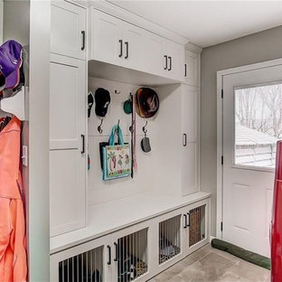 Photo of a transitional laundry room in Other with a side-by-side washer and dryer.
